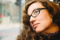 Melancholic woman close-up on a bus
