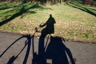 Blurred shadow of a biker