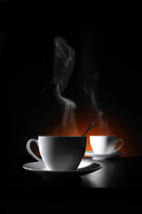 Two cups with hot coffee