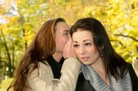 girlfriends whispering