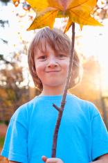Boy Holding a Brown Leaf