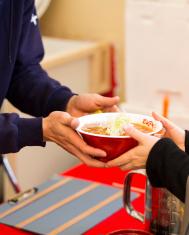 Passing a Bowl of Ramen Noodles