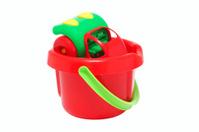 Plastic toy car inside the bucket.
