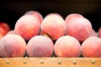 fresh red peach in basket