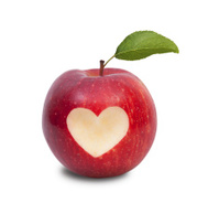 Healthy lifestyle concept apple with heart symbol and leaf