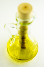 Olive oil in a bottle with olives