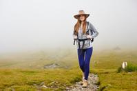 Female hiker on a mountain trail
