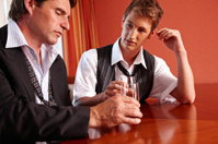 Drunken businessmen older and younger men