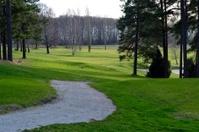 Golf hole in shadows
