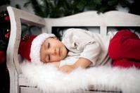 Little baby boy, sleeping on a bench