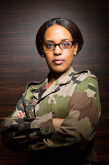 Portrait of a woman in army gear