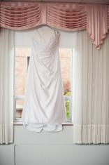 Wedding Dress Hanging Up in Window