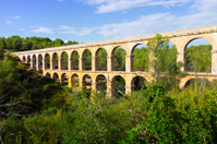 Antique roman aqueduct in  forest. Tarragona