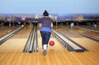 Young girl playing bowling