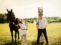 wedding of unusual couple happy near horses