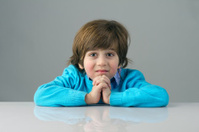 beautiful kid with deep thoughts thinking isolated against grey