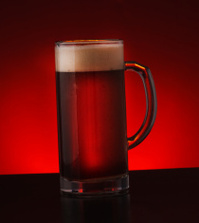 Beer glass on dark background