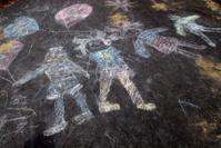 Sidewalk chalk of happy kids