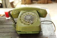 Old green vintage telephone