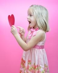 Little girl reading Valentine's card