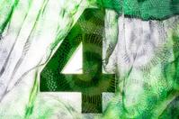 Number 4 under vintage green fabric