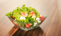 Green salat in a bowl on desk