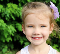 Outdoor portrait of cute smiling little girl