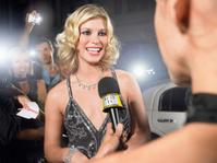 Celebrity Being Interviewed By Journalist