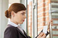 Woman uses electronic pass.