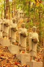 Statues of begging monks, Phnom Sombok, Kratie, Cambodia