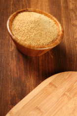 Cane Sugar in wooden bowl