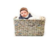 Newborn Baby Girl in Basket White Background