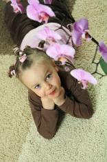 Girl with flower on carpet