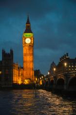 Big Ben at night with Westminster bridge vertical