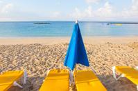 umbrellas and empty beach couches