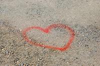 Love heart painted on the street asphalt