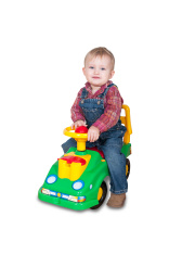 little boy riding a toy car