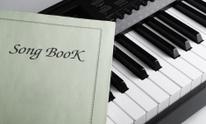 Piano keys and song book