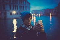 Girl taking photo in Venice