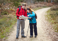 Couple hiking checking map