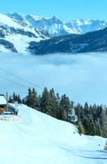 Winter sunny mountain and ski lift