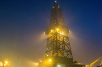oil rig platform on a foggy night at sea