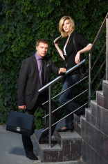 Young business couple on the steps