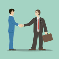 businessmans shaking hands signing an important deal leading suc