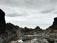 Rocks, sea and cloudy sky