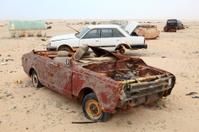 Abandoned cars in the desert