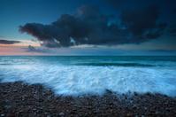 waves on Atlantic ocean coast at sunset