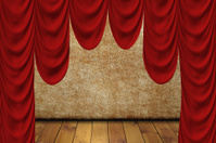 Theater scene with red curtain.
