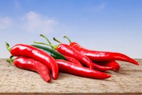 Chilli Peppers on Rustic Background