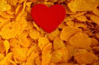 Health diet concept, healthy breakfast. Love corn flakes backgro